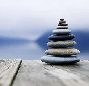 Photo of a pile of stones | The Mooring Counselling Service